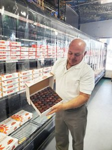 Ahmad Fejleh, the owner of Westmorland Date Shake, shows off some of his shop's date products, but it also offers a wide variety of specialty foods.