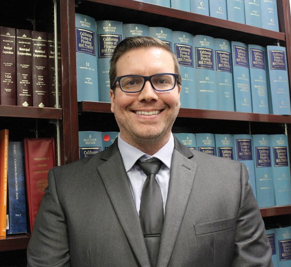 Adam Crook Appointed as New County Counsel